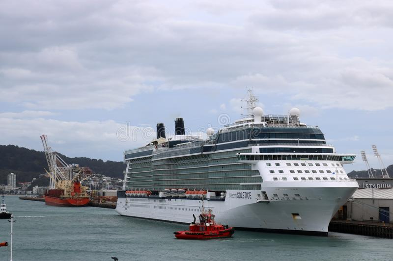 Cruise ship Celebrity Solstice in Wellington NZ. Cruise ship Celebrity Solstice at Aotea Quay in Wellington harbour New Zealand on 7th November 2017 along with stock photography
