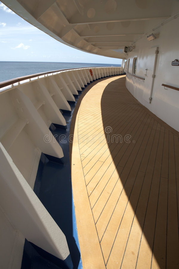 Cruise ship deck. View of an empty cruise ship deck sweeping around the bow of the ship royalty free stock photo