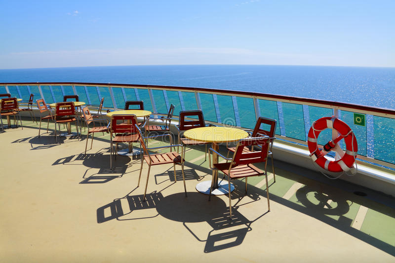 Cruise ship deck. With table and chairsl stock photos