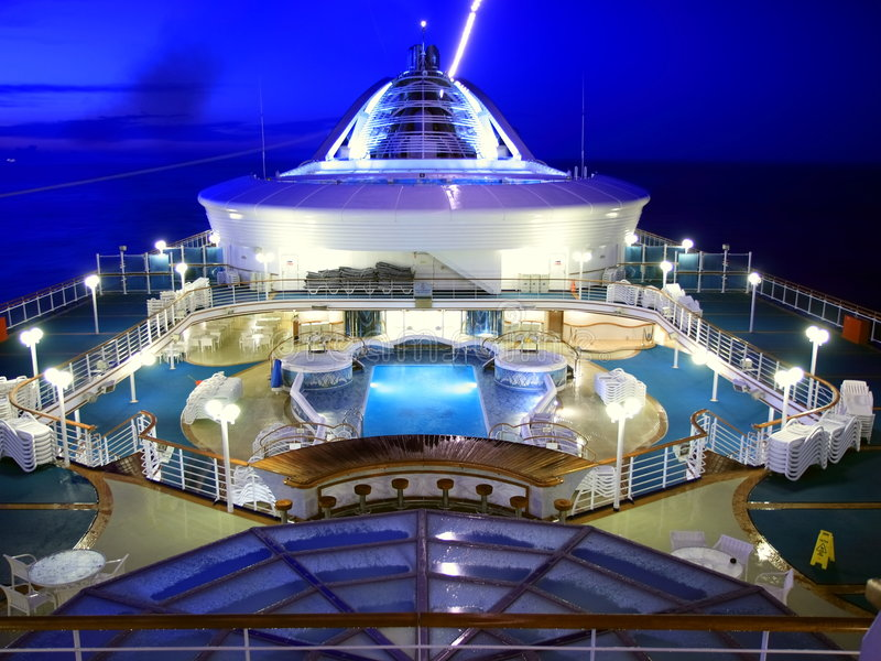 Cruise ship deck. At night with blues sky stock photos