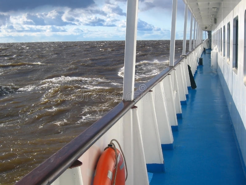 Cruise ship deck in the sea with strong waves royalty free stock photography