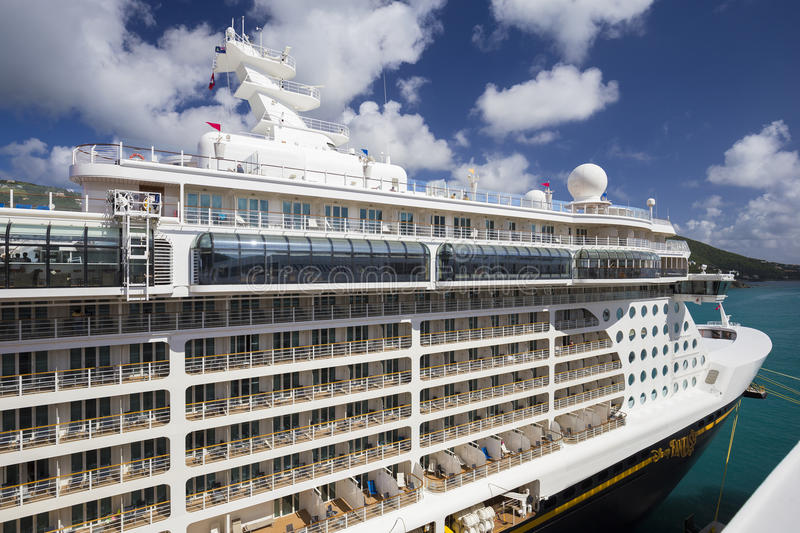 Cruise ship Disney Fantasy docked in the port of Road Town. Road Town, British Virgin Islands - January 05, 2016: Cruise ship Disney Fantasy docked in the port stock photos