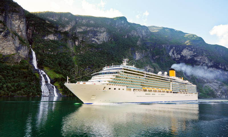 Cruise ship in fiord. Cruise liner in the Geiranger fjord listed as a UNESCO World Heritage Site royalty free stock image