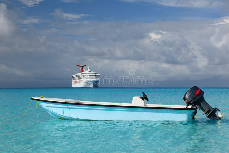 Cruise Ship And Fishing Boat In Blue Ocean Stock Photo