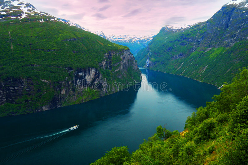 Cruise ship in fjord. Day shot of lush mountains and river, Geiranger fjord in Norway royalty free stock photos