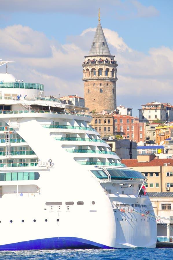 Cruise ship and Galata Tower. A big cruise ship and Istanbul Galata Tower stock photo
