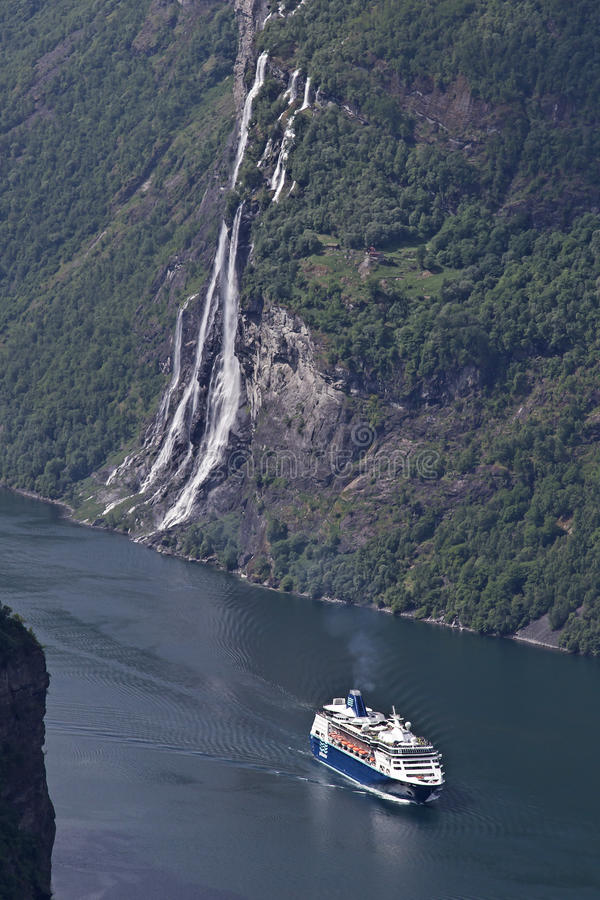 Cruise ship in Geiranger Fjord. The epitome of Norwegian scenery and popular tourist destination stock photos