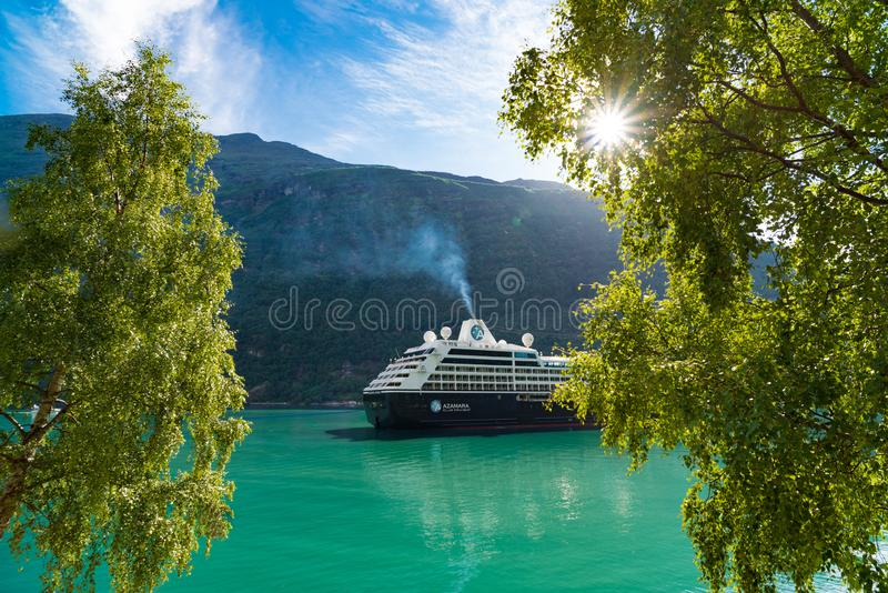 Cruise ship in Geiranger fjord royalty free stock images
