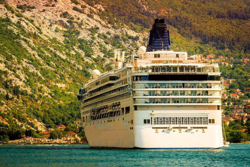 Cruise ship in the Gulf of Boko Kotor on the Adriatic Sea in the midst of amazing mountains royalty free stock images