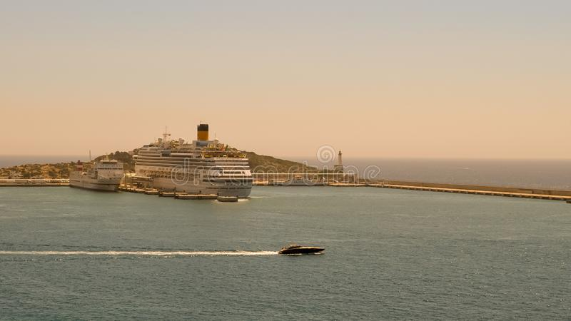 Cruise Ship in the Harbour in Ibiza Spain. Boat, travel, vacation, hotel, water, sea, mediterranean, ocean, island, motor, wave, sky, light, hiuse, house, dock stock images