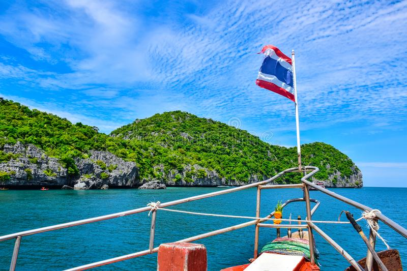 Cruise ship with Thailand national flag heading to Angthong island national marine park near Samui island through a very beautiful royalty free stock photography