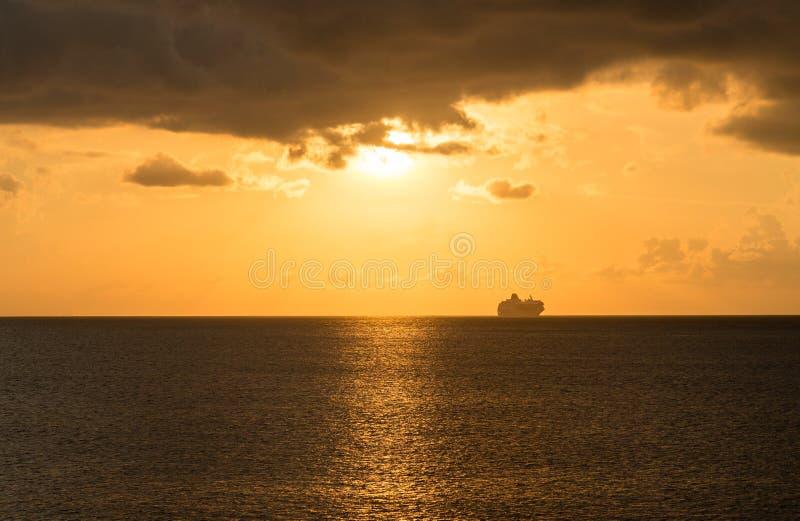 Cruise Ship On Horizon At Sunset Stock Photography