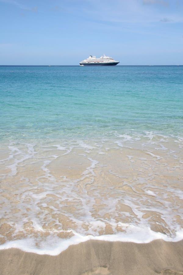 Cruise ship on the horizon of tropical beach stock photography
