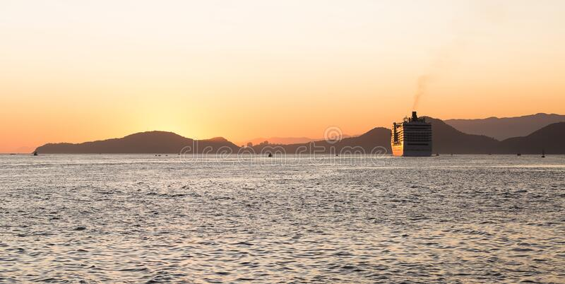 A cruise ship leaving the port of Santos, Brazil, during a beautiful summer sunset.  royalty free stock photos