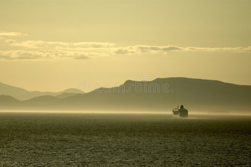 Cruise ship in misty fjord royalty free stock image