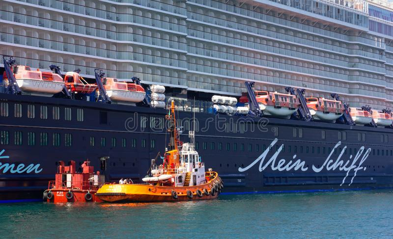 Cruise Ship Moored in Trieste. TRIESTE, Italy - June 16, 2019: Closeup of the cruise ship Mein Schiff 6 moored next to the Audace pier royalty free stock photos