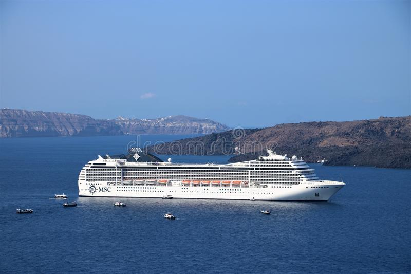 Cruise ship MSC Musica. Anchored near the Greek island of Santorini. MSC Musica is the first Musica-class cruise ship built in 2006 and operated by MSC Cruises royalty free stock photos