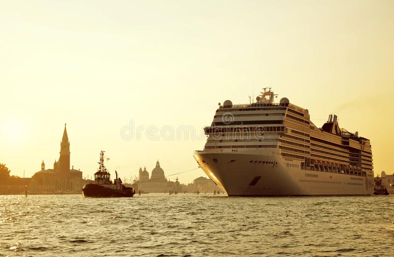 Cruise ship MSC Poesia sailing through the canal at sunset. royalty free stock images