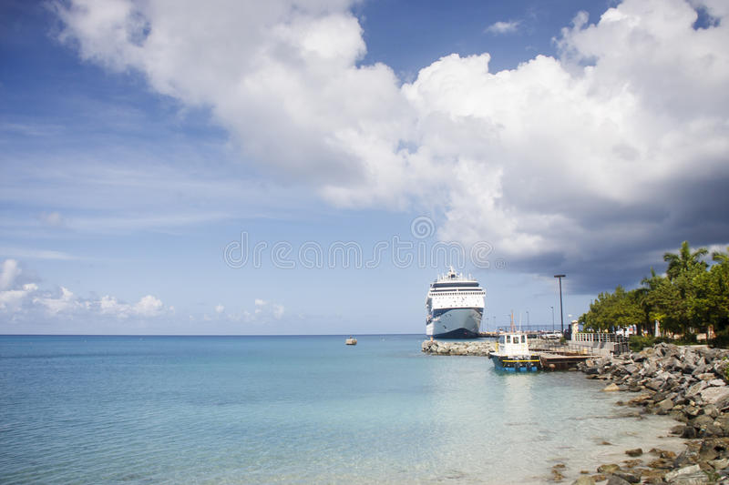 Download Cruise Ship At Pier Near Tugboat Stock Photo - Image: 25464550
