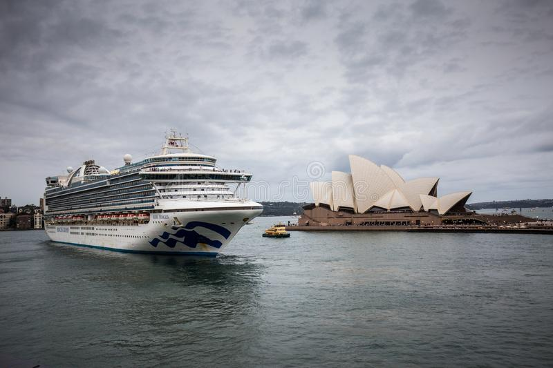 Cruise ship Ruby Princess next to OperaHouse in Sydney Harbour royalty free stock photography