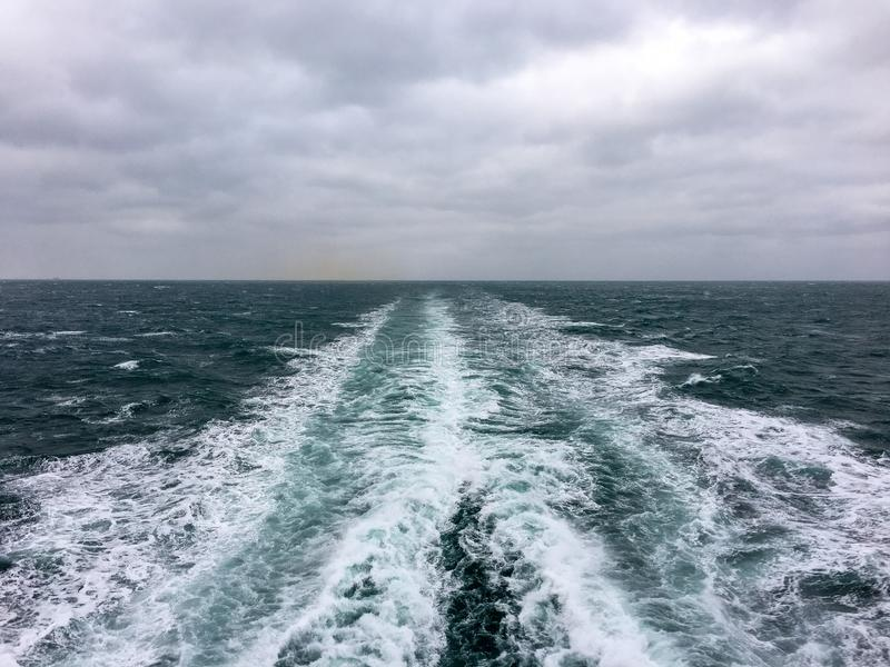 Cruise ship`s wake. In rough sea stock images