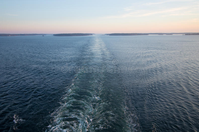 Cruise ship`s wake. Cruise ship`s wake in the Stockholm archipelago in Sweden stock photos