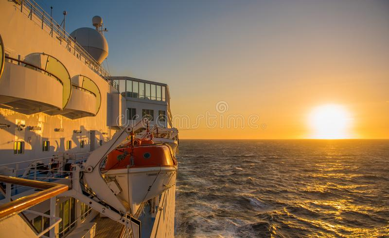 Cruise ship sailing in sunset on Atlantic Ocean stock images