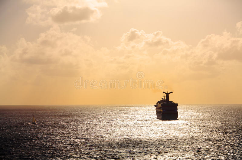 Cruise ship sailing into sunset royalty free stock photos