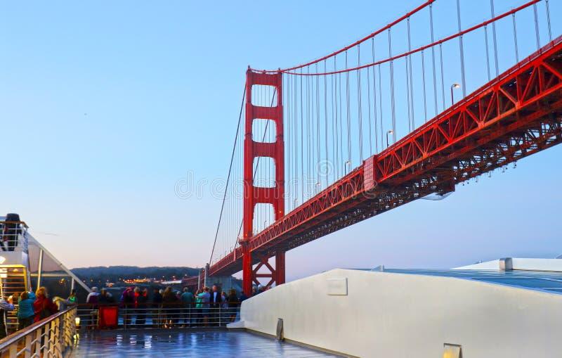 Cruise Ship Sailing Through under Golden Gate Bridge, view from under bridge deck, San Francisco, California, USA. stock photo
