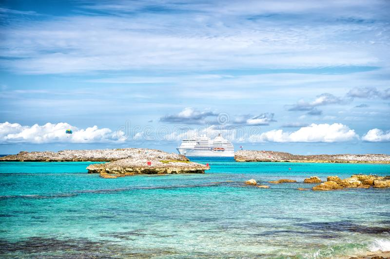 Cruise ship in sea in Great stirrup cay, Bahamas on sunny day. Ocean liner in turquoise water on blue sky. Summer vacation on cari stock photography