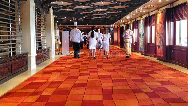 Cruise ship crew on their way to work royalty free stock images
