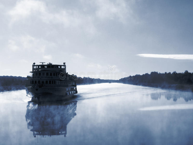 Cruise ship in still waters in the morning stock photo