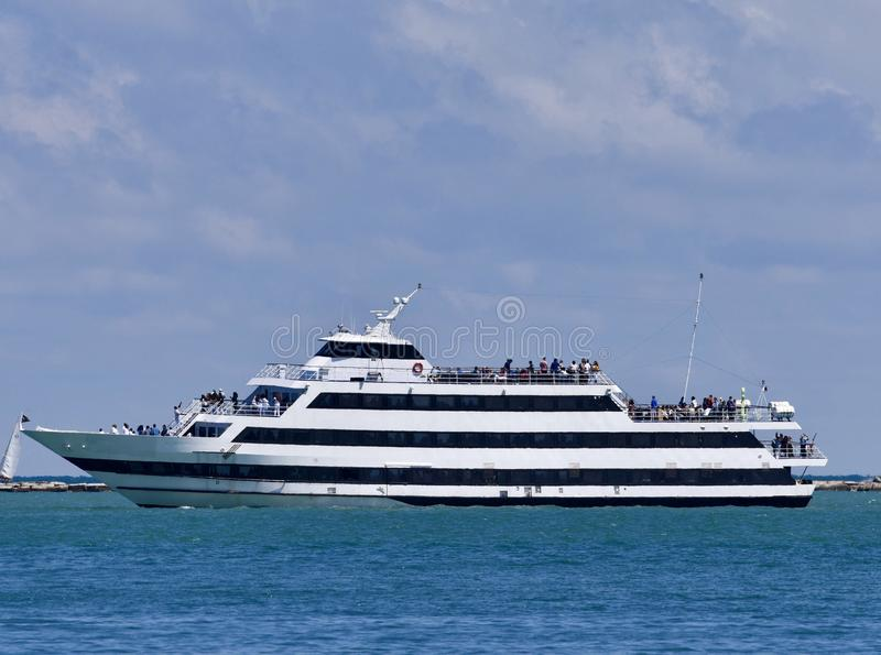 Cruise Ship. This is a Summer picture of a Lake Michigan cruise ship off the coast of Chicago, Illinois in Cook County. This dour deck Ship is has been harbored royalty free stock photos