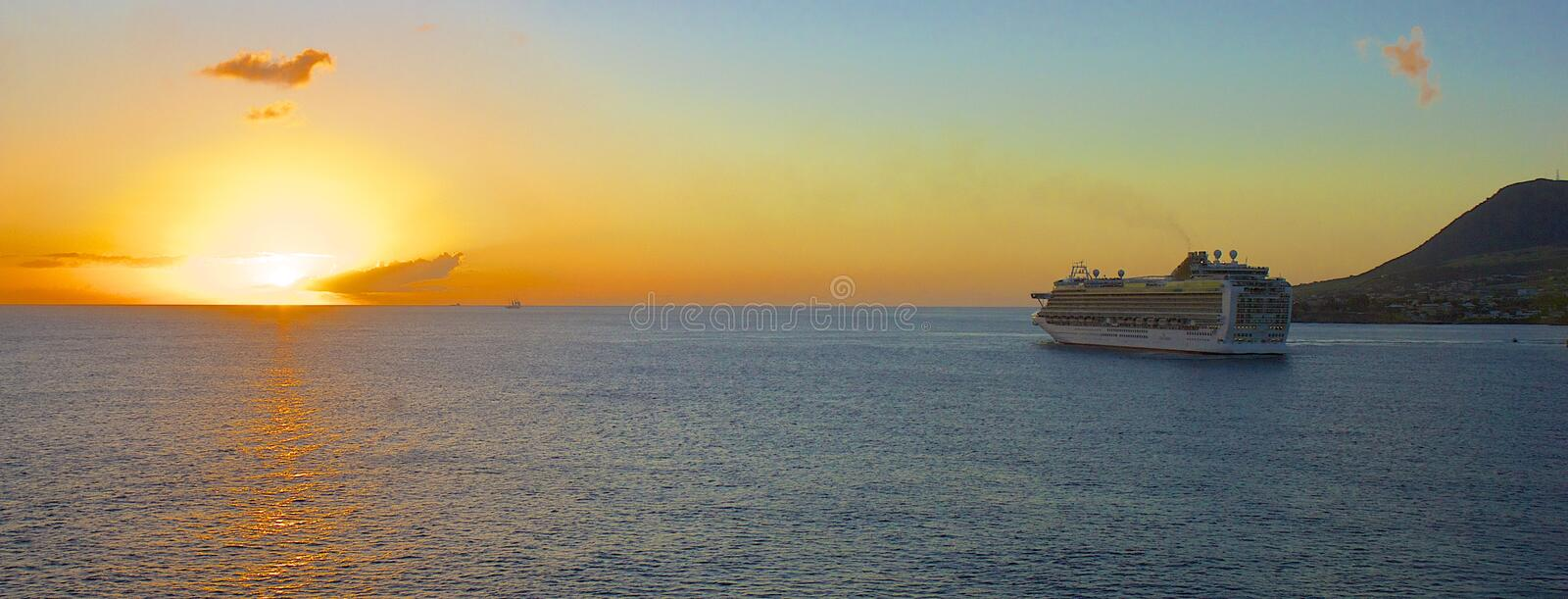 Cruise ship on a sunset, St Kitts. Cruise ship leaving St Kitts on the sunset royalty free stock photos