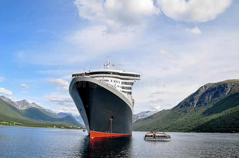 Cruise Ship with Tenders. Cruise ship at anchor with tenders alongside royalty free stock photography