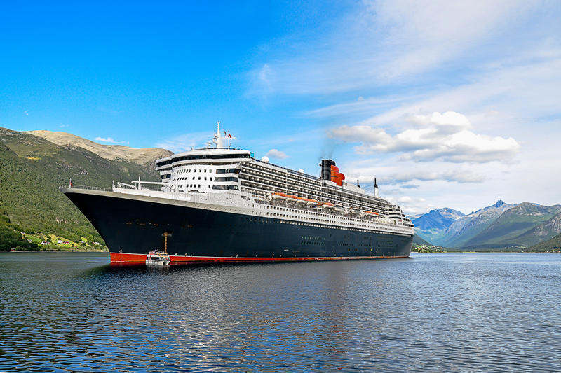 Cruise Ship with Tenders. Cruise ship at anchor with tenders alongside stock photos