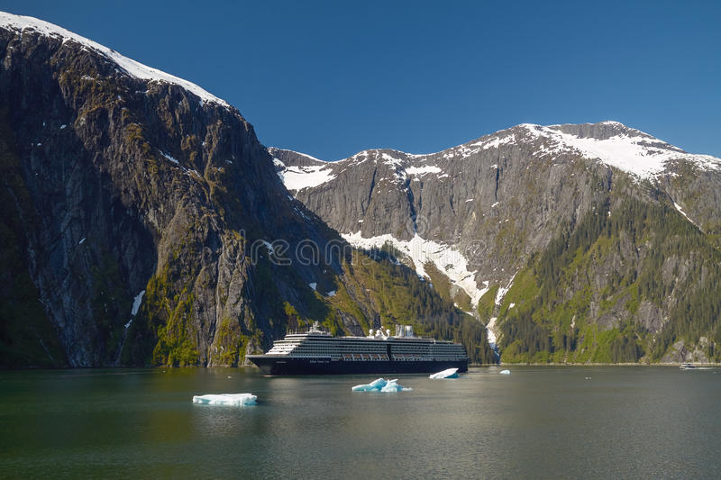 Cruise Ship at Tracy Arm Fjords in Alaska, United States. TRACY ARM FJORDS, ALASKA, USA - MAY 30, 2011: Holland America Line Cruise Ship at Tracy Arm Fjords in stock photo