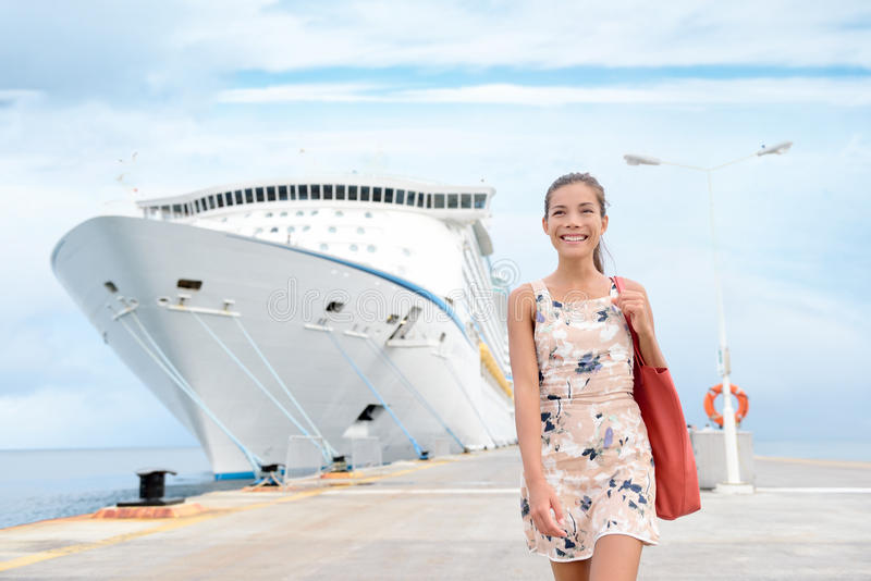 Cruise ship travel woman going shopping in port stock photo