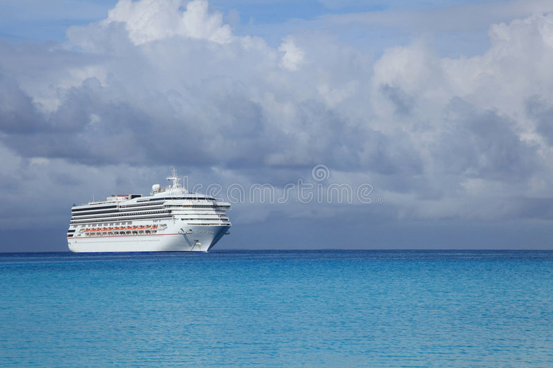 Cruise ship in tropical island port royalty free stock photo