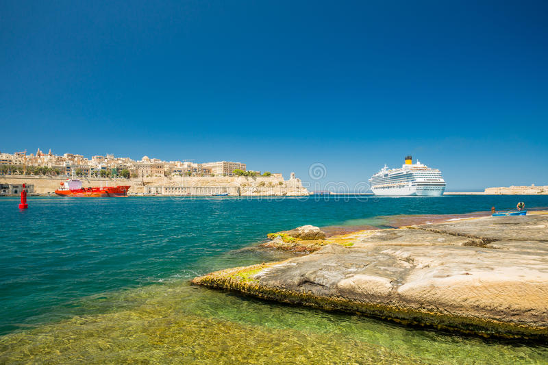 Cruise ship and Valletta harbor view from Birgu. Malta. stock photos