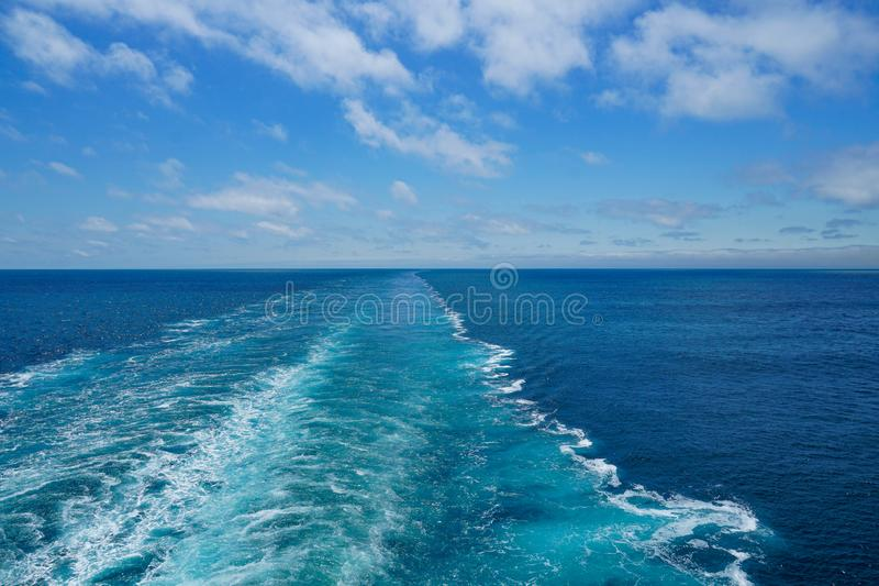 Cruise ship wake. On a beautiful sunny day with white clouds and blue seas on the Atlantic Ocean, asian, attractive, background, bermuda, boat, bosphorus stock photography