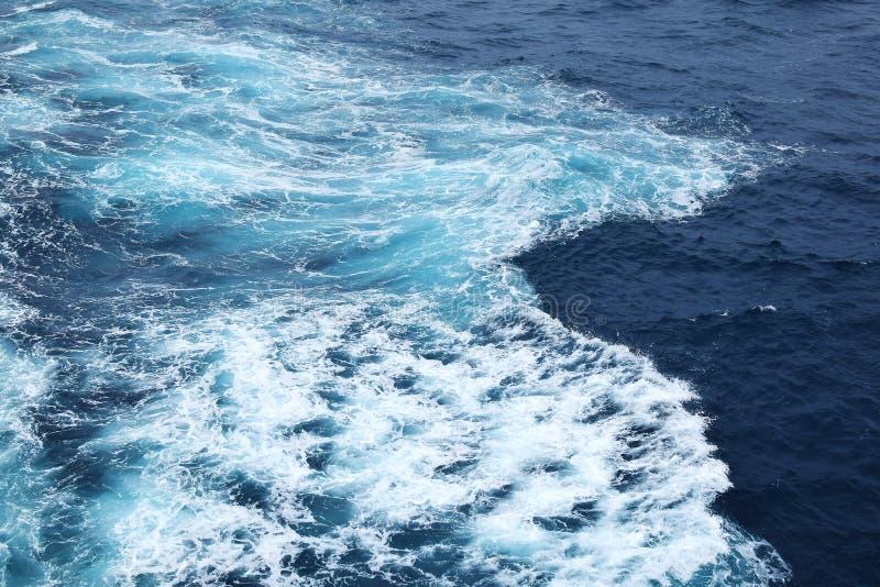 Cruise ship wake. Over blue ocean stock photo