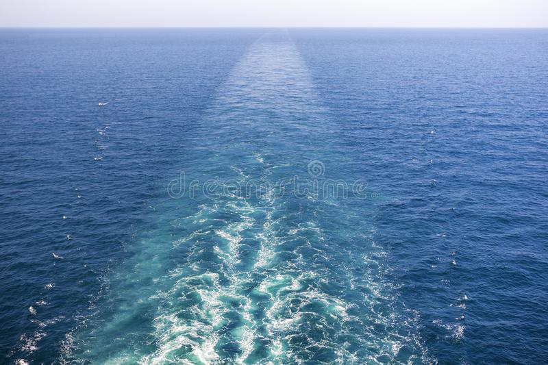 Cruise ship wake or trail on ocean surface, white trace. Cruise ship wake on the sea surface, ocean boat foam trail stock images