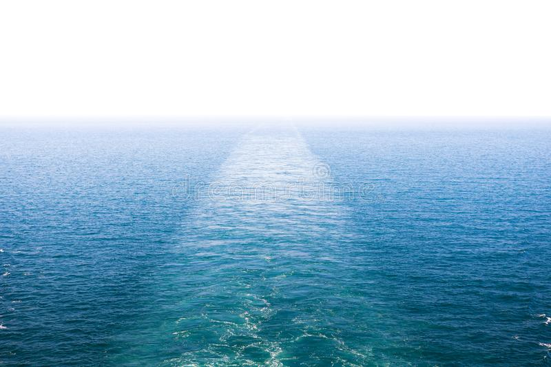Cruise ship wake or trail on ocean surface, white trace. Cruise ship wake on the sea surface, ocean boat foam trail royalty free stock image