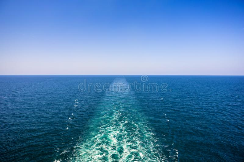 Cruise ship wake or trail on ocean surface, white trace. Cruise ship wake on the sea surface, ocean boat foam trail stock photography