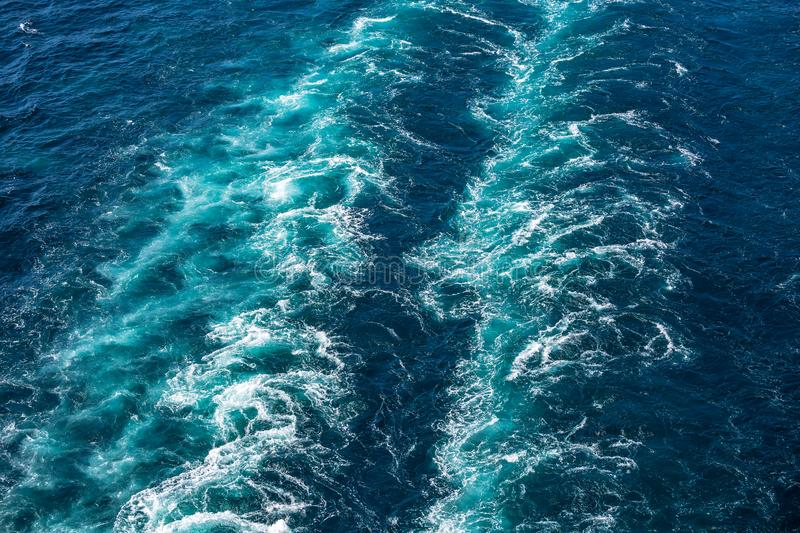 Cruise ship wake or trail on ocean surface, white trace. Cruise ship wake on the sea surface, ocean boat foam trail royalty free stock photo