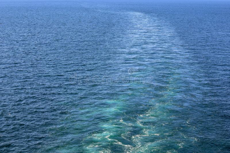 Cruise ship wake or trail on ocean surface, white trace. Cruise ship wake on the sea surface, ocean boat foam trail royalty free stock photos