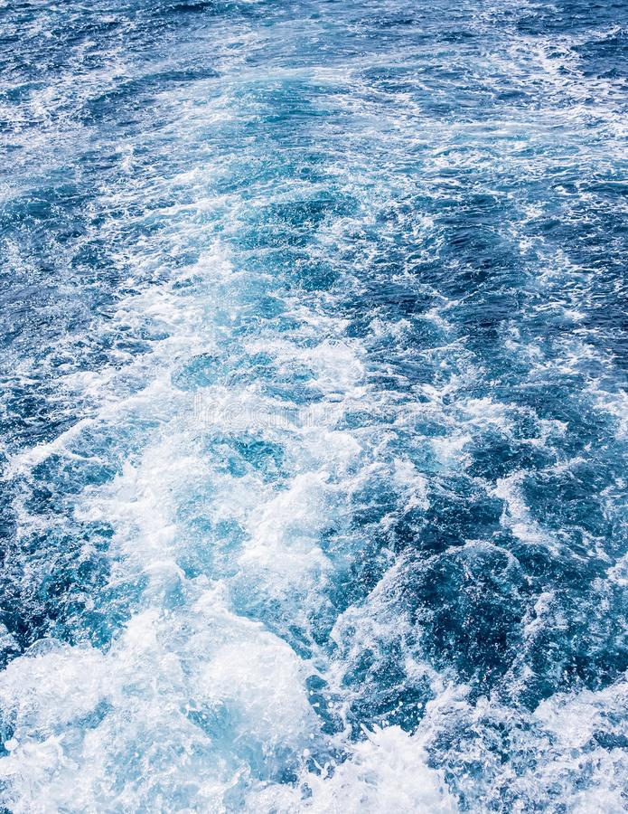 Ship wake Wave ocean trace on blue sea water background. Ship wake Wave ocean trace on blue sea fresh water background stock photo