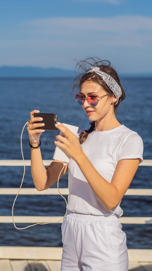 Cruise Ship Woman Using Mobile Phone On Travel Vacation At