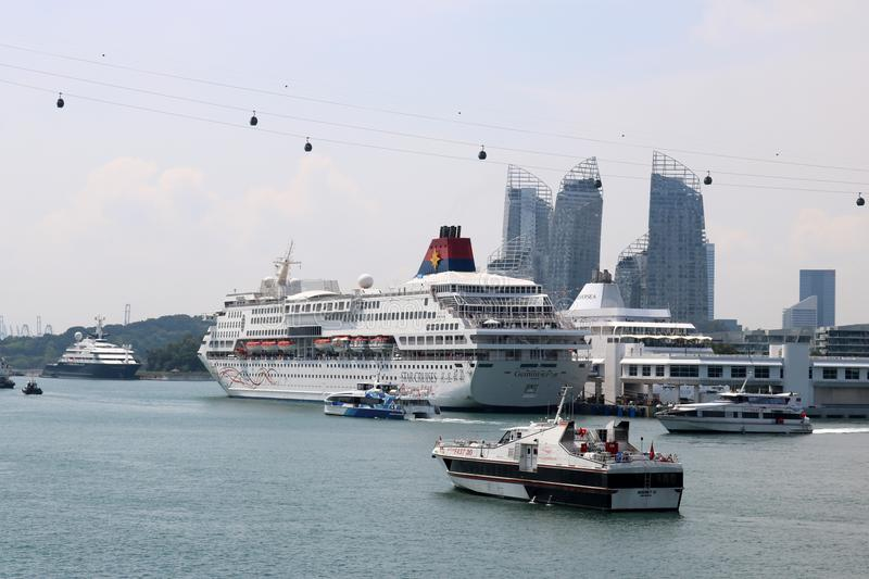 Cruise ships and cable car, Singapore harbor royalty free stock image
